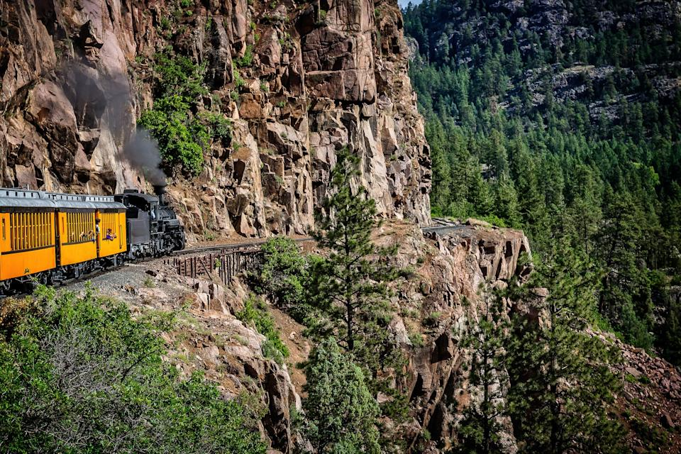 The Durango Silverton Narrow Gauge Railroad takes passengers along sheer cliffs and around mountain bends.