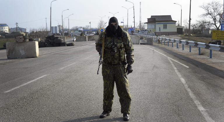 Pro-Russian serviceman at the Chongar check point blocks the entrance to Crimea on March 7, 2014