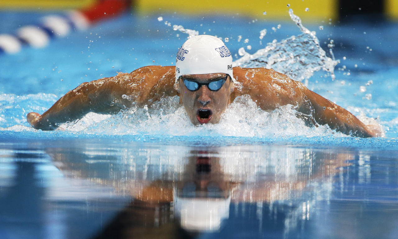 Michael Phelps swims in the men's 200-meter butterfly semifinal at the U.S. Olympic swimming trials, Wednesday, June 27, 2012, in Omaha, Neb. (AP Photo/Mark Humphrey)