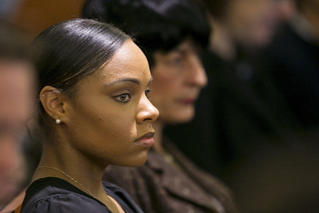 Shayanna Jenkins, fiancee of former NFL player Aaron Hernandez, listens during the murder trial for Hernandez at the Bristol County Superior Court in Fall River, Massachusetts, April 15, 2015. Hernandez, 25, a former tight end for the New England Patriots, is accused of fatally shooting semiprofessional football player Odin Lloyd in an industrial park near Hernandez's Massachusetts home in June 2013. REUTERS/Dominick Reuter