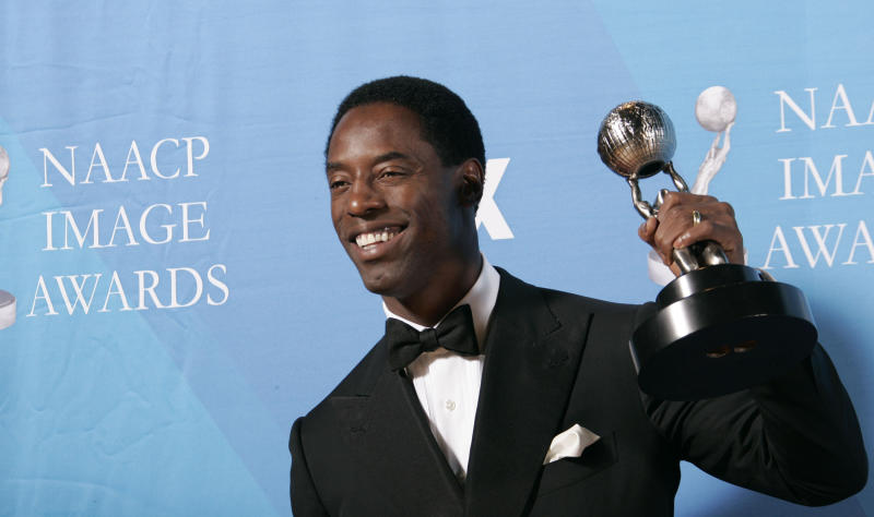 "Isaiah Washington holds the award for outstanding actor in a drama series for his work on ""Grey's Anatomy"" at the 38th NAACP Image Awards, Friday, March 2, 2007, in Los Angeles. (AP Photo/Reed Saxon)"