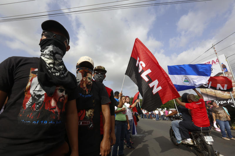 Sandinista supporters of President Daniel Ortega wait for his arrival in Masaya, Nicaragua, Friday, July 13, 2018. According to human rights groups, more than 300 person have been killed since April 19, since demonstrations erupted against the government of President Ortega. Most of them opponents of the regime. (AP Photo/Alfredo Zuniga)