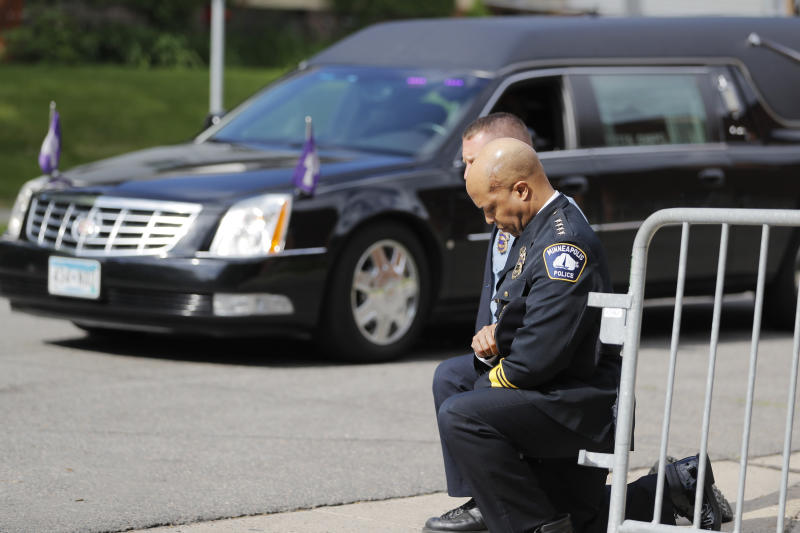 FILE - In this June 4, 2020, file photo, police officers including Minneapolis Police Chief Medaria Arradondo, foreground, take a knee as the body of George Floyd arrives before his memorial services in Minneapolis.  George Floyd's death and the protests it ignited nationwide over racial injustice and police brutality have raised questions about whether Arradondo — or any chief — can fix a department that's now facing a civil rights investigation. (AP Photo/Julio Cortez, File)