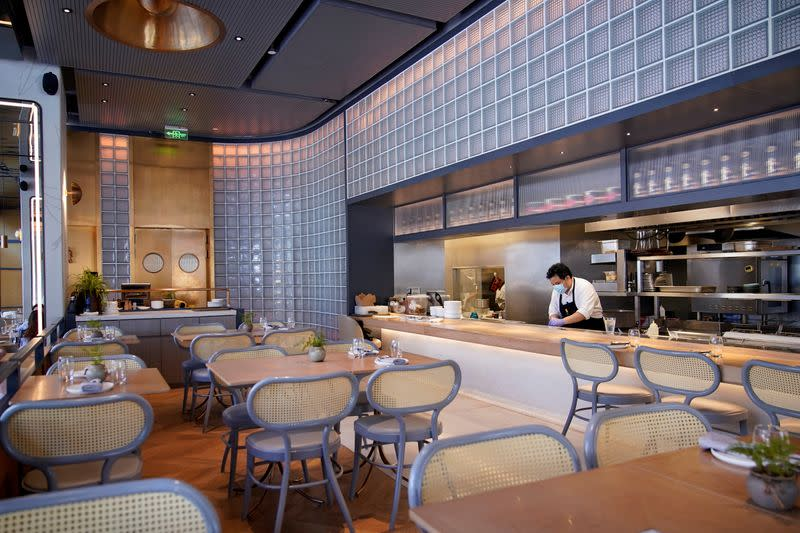 Chef and owner Austin Hu works at his restaurant Heritage by Madison, in Shanghai