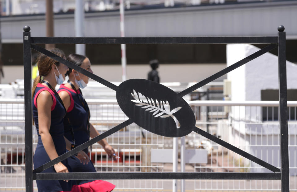 Festival employees walk past a Palme d'Or sign on a railing during preparations for the 74th international film festival, Cannes, southern France, July 5, 2021. The Cannes film festival runs from July 6 - July 17. (AP Photo/ Vadim Ghirda)