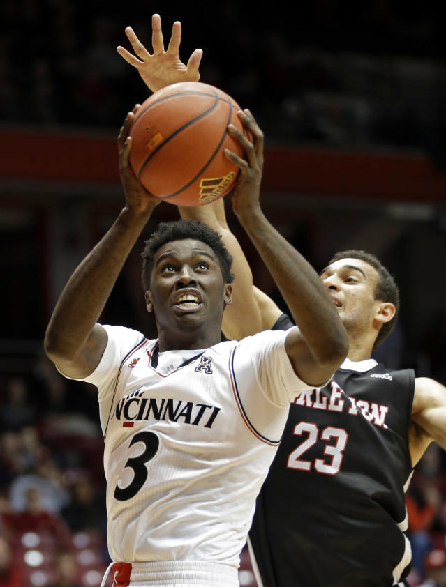 Cincinnati forward Shaquille Thomas (3) shoots against Carleton guard Phillip Scrubb (23) in the first half of an NCAA exhibition college basketball game, Saturday, Oct. 26, 2013, in Cincinnati. (AP Photo/Al Behrman)