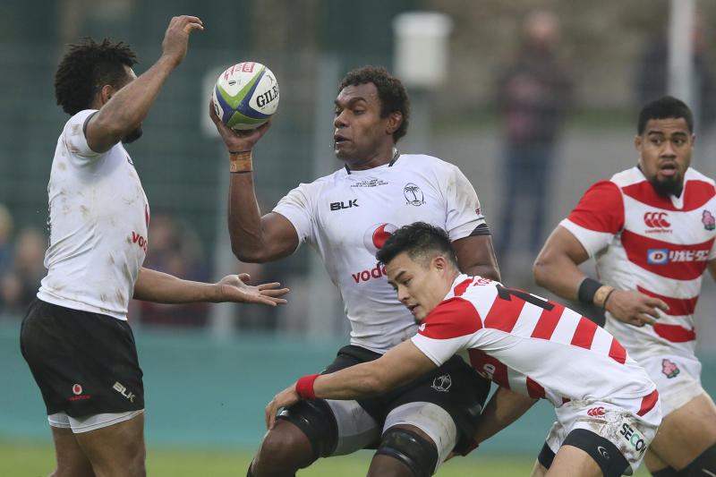 FILE - In this Nov. 26, 2016, file photo, Fiji's Leone Nakarawa, center, catches the ball during an international rugby union test match between Fiji and Japan at Stade de la Rabine in Vannes, western France. Teams from the Pacific islands are immensely popular around the world and their appearances at the Rugby World Cup are likely to attract large and admiring crowds. But an appreciative welcome won't disguise the fact that the Pacific nations begin the tournament under a considerable handicap. (AP Photo/David Vincent, File)