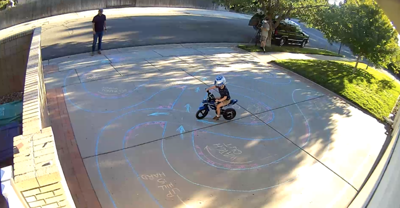 Four-year-old Quinn rides his bicycle in the racetrack created by his neighbor Dave Palazzolo. / Credit: Dave Palazzolo