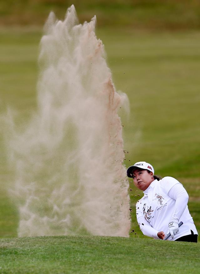 South Korea's Sun Ju Ahn watches her shot from the bunker onto the 18th green during the third day of the Women's British Open golf championship at the Royal Birkdale Golf Club, Southport, England, Saturday July 12, 2014. (AP Photo/Scott Heppell)