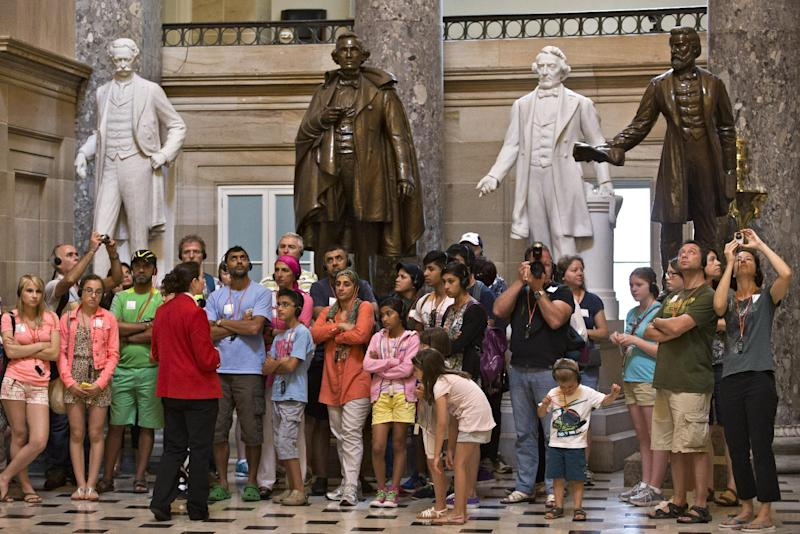 Visitors gather for a tour in Statuary Hall at the Capitol in Washington, Tuesday, July 2, 2013. The National Statuary Hall Collection in the Capitol displays two statues from each state to honor the nation's founders, leaders and legends. (AP Photo/J. Scott Applewhite)