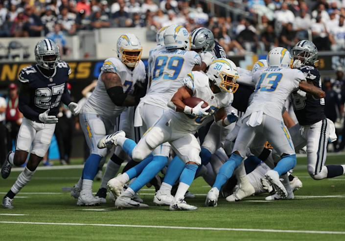 Chargers running back Austin Ekeler looks for a hole to punch through the Dallas Cowboys' defensive line.