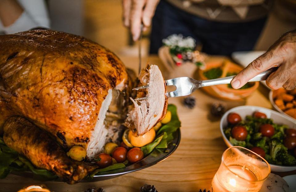 """<p>For a first-time Thanksgiving host, figuring out <a href=""""https://www.thedailymeal.com/how-much-turkey-per-person?referrer=yahoo&category=beauty_food&include_utm=1&utm_medium=referral&utm_source=yahoo&utm_campaign=feed"""" rel=""""nofollow noopener"""" target=""""_blank"""" data-ylk=""""slk:how much turkey to buy per guest"""" class=""""link rapid-noclick-resp"""">how much turkey to buy per guest</a> can be overwhelming. But it's actually pretty simple: You're going to want about a pound to a pound and a half per person. While the goal is to stuff your face on Thanksgiving, each individual isn't <em>actually</em> expected to eat 24 ounces of turkey that day. That weight also takes into account the turkey carcass, giblets and an ample amount of leftovers.</p>"""