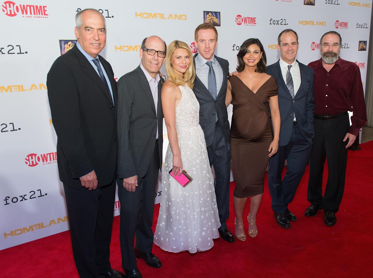 """WASHINGTON, DC - SEPTEMBER 09: (L-R) Co-Chairman of Fox 20th TV Gary Newman, CEO & Chairman of Showtime Networks Matthew C. Blank, Claire Danes, Damian Lewis, Morena Baccarin, President of Entertainment at Showtime Networks David Nevins and Mandy Patinkin attend a premiere screening hosted by SHOWTIME and Fox 21 for Season 3 of the hit series """"Homeland"""" at Corcoran Gallery of Art on September 9, 2013 in Washington City. (Photo by Daniel Boczarski/Getty Images for Showtime)"""