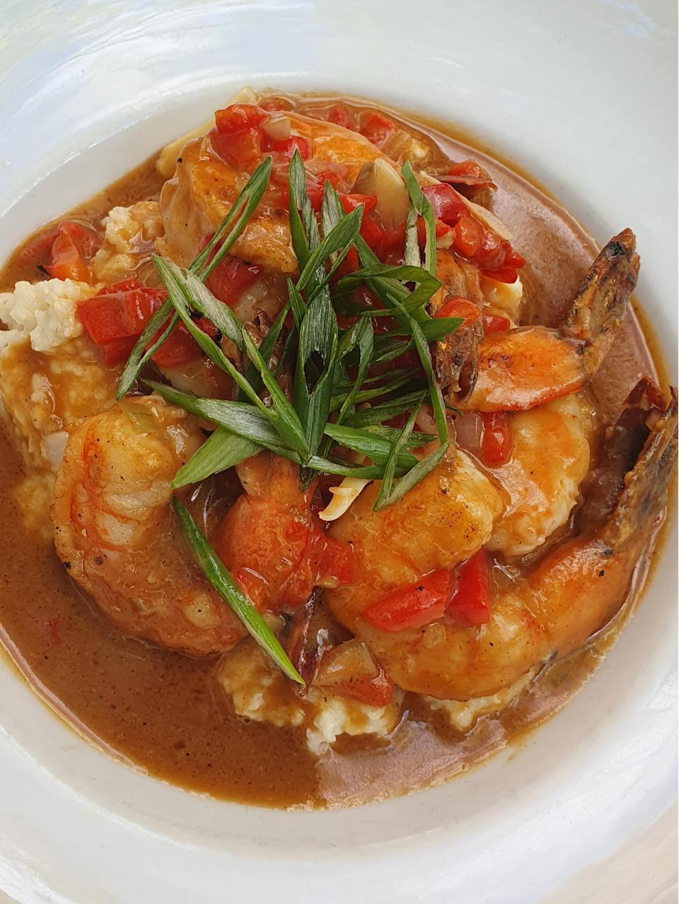 """<p>This shrimp etouffee and grits recipe adds flavor to traditional grits using the light roux from the etouffee with shrimp scattered on top. It's the perfect mashup of traditional Southern food and <a href=""""https://www.thedailymeal.com/cook/louisiana-cajun-creole-mardi-gras-recipes?referrer=yahoo&category=beauty_food&include_utm=1&utm_medium=referral&utm_source=yahoo&utm_campaign=feed"""" rel=""""nofollow noopener"""" target=""""_blank"""" data-ylk=""""slk:classic Cajun recipes"""" class=""""link rapid-noclick-resp"""">classic Cajun recipes</a>.</p> <p><a href=""""https://www.thedailymeal.com/best-recipes/creole-shrimp-etouffee-grits?referrer=yahoo&category=beauty_food&include_utm=1&utm_medium=referral&utm_source=yahoo&utm_campaign=feed"""" rel=""""nofollow noopener"""" target=""""_blank"""" data-ylk=""""slk:For the Shrimp Etouffee and Grits recipe, click here."""" class=""""link rapid-noclick-resp"""">For the Shrimp Etouffee and Grits recipe, click here. </a></p>"""