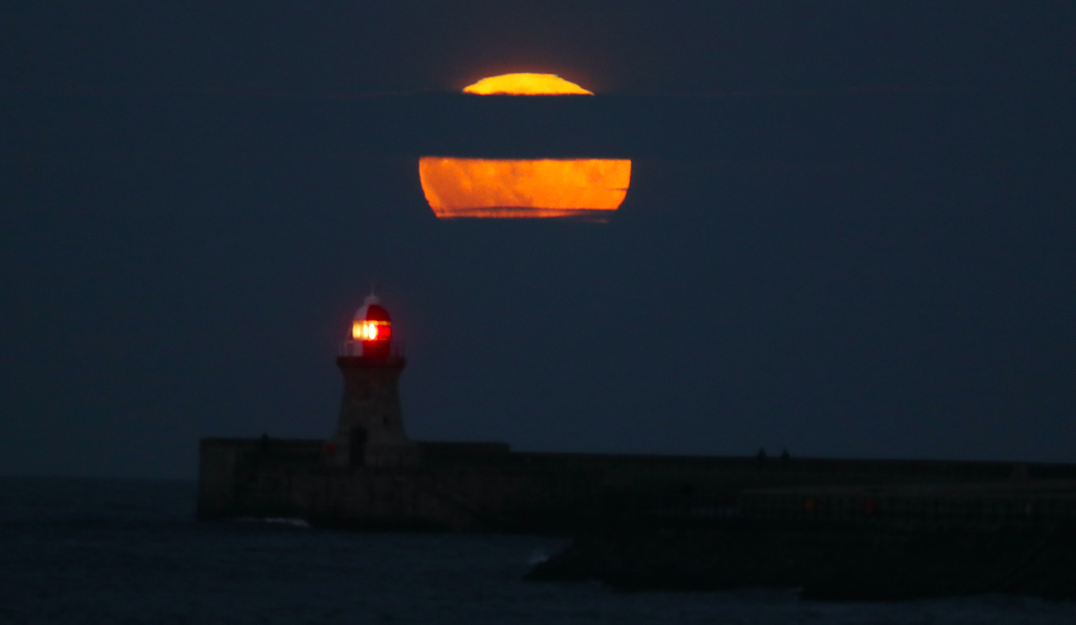 <p>An other-wordly orange glow made the Supermoon appear decidedly filmic. (PA) </p>