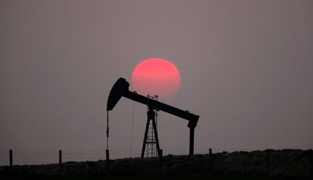 Oil falls on weaker economic growth forecasts and swelling US crude stocks