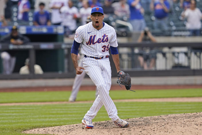 New York Mets relief pitcher Edwin Diaz reacts after striking out a batter to end the top of the eighth inning of a baseball game against the Pittsburgh Pirates at Citi Field, Sunday, July 11, 2021, in New York. (AP Photo/Seth Wenig)
