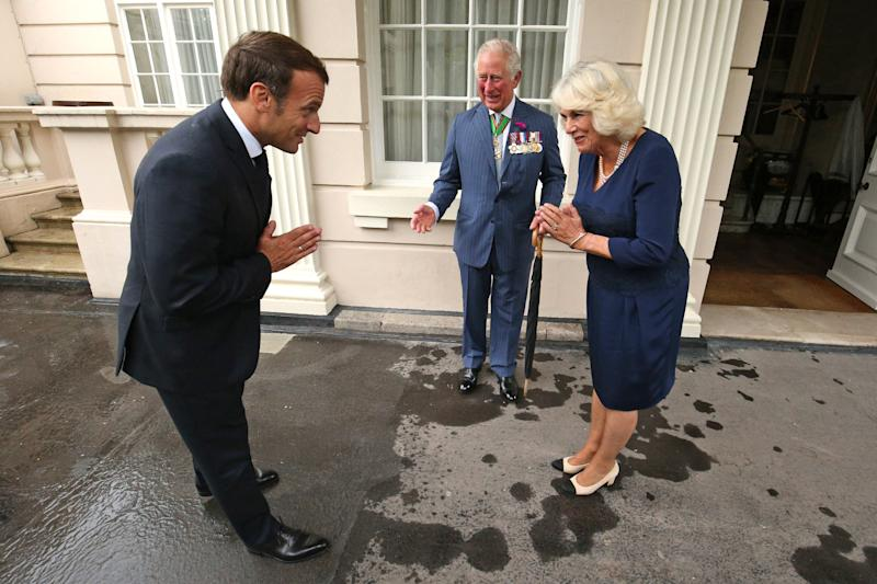 LONDON, ENGLAND - JUNE 18: Prince Charles, Prince of Wales and Camilla, Duchess of Cornwall greet French President Emmanuel Macron with a namaste gesture as he arrives at Clarence House on June 18, 2020 in London, England. L'Appel du 18 Juin (The Appeal of 18 June) was the speech made by Charles de Gaulle to the French in 1940 and broadcast in London by the BBC. It called for the Free French Forces to fight against German occupation. The appeal is often considered to be the origin of the French Resistance in World War II. President Macron is the first foreign dignitary to visit the UK since the coronavirus lockdown began. (Photo by Jonathan Brady - WPA Pool/Getty Images)