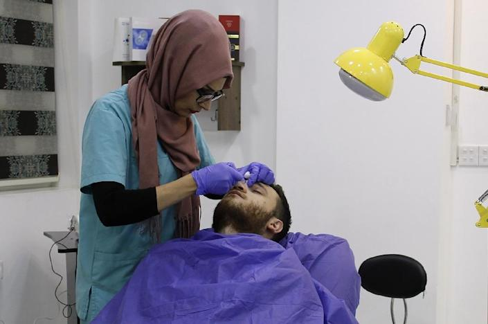 Most customers at the new clinics are men (AFP Photo/Zaid AL-OBEIDI)