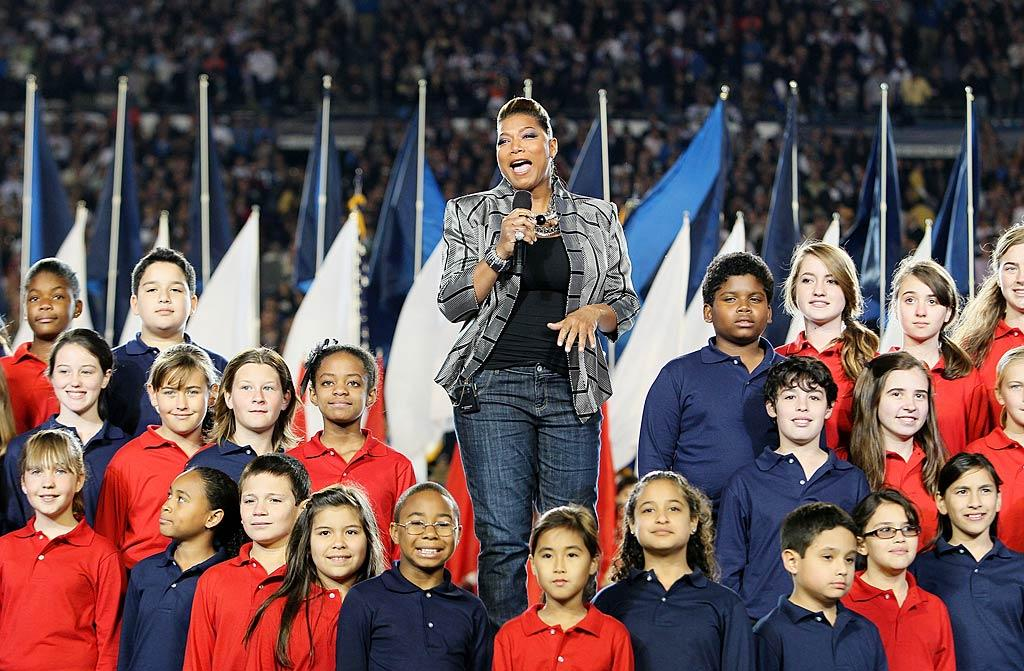 "Queen Latifah was backed by a children's chorus -- and plagued by a few technical problems -- while performing ""America the Beautiful"" during the pre-show. Andy Lyons/<a href=""http://www.gettyimages.com/"" target=""new"">GettyImages.com</a> - February 7, 2010"