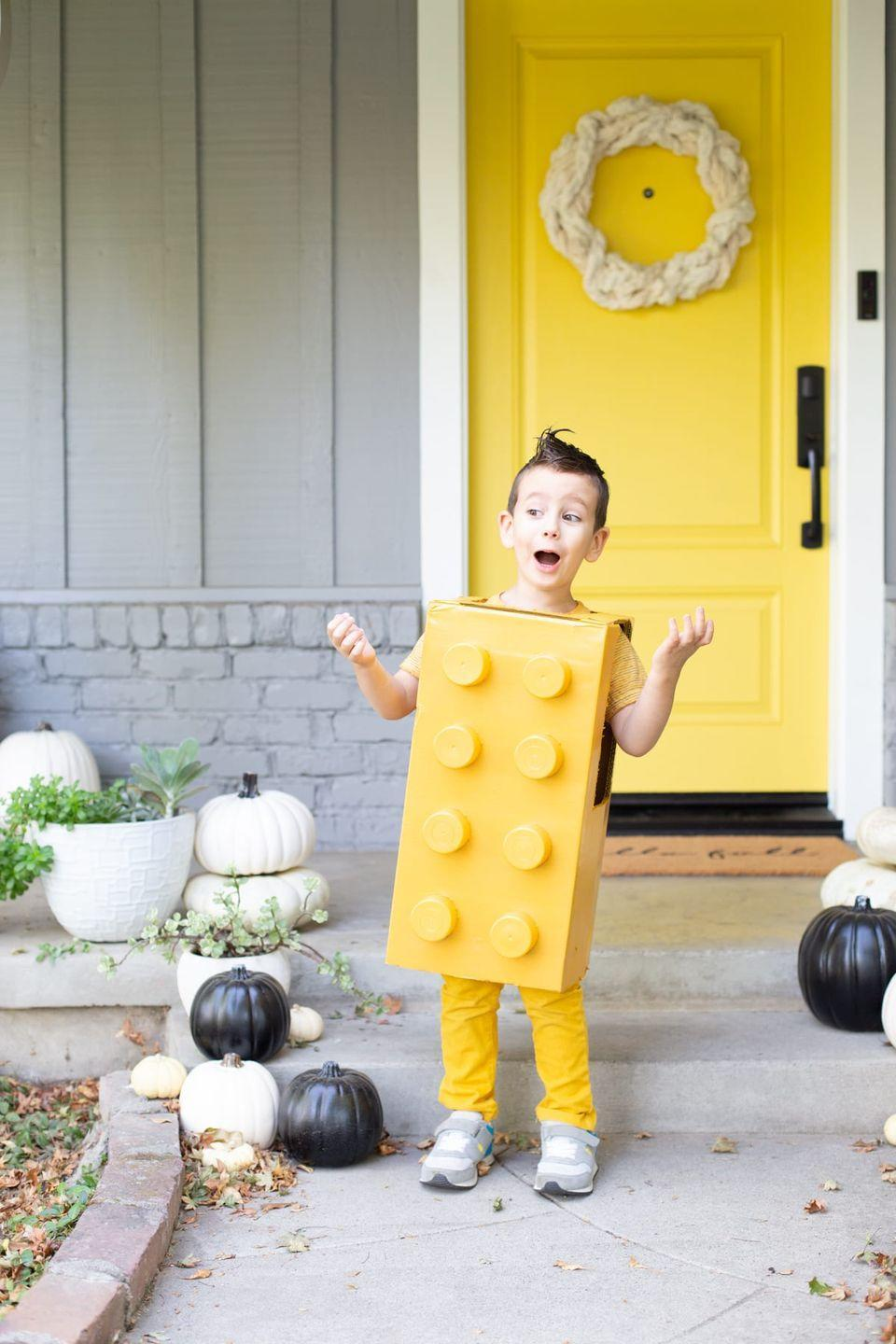 """<p>This <a href=""""https://lovelyindeed.com/lego-costume-diy-halloween/"""" rel=""""nofollow noopener"""" target=""""_blank"""" data-ylk=""""slk:DIY LEGO"""" class=""""link rapid-noclick-resp"""">DIY LEGO</a> look will thrill your little one this Halloween. Play-time not is over yet!<br></p>"""
