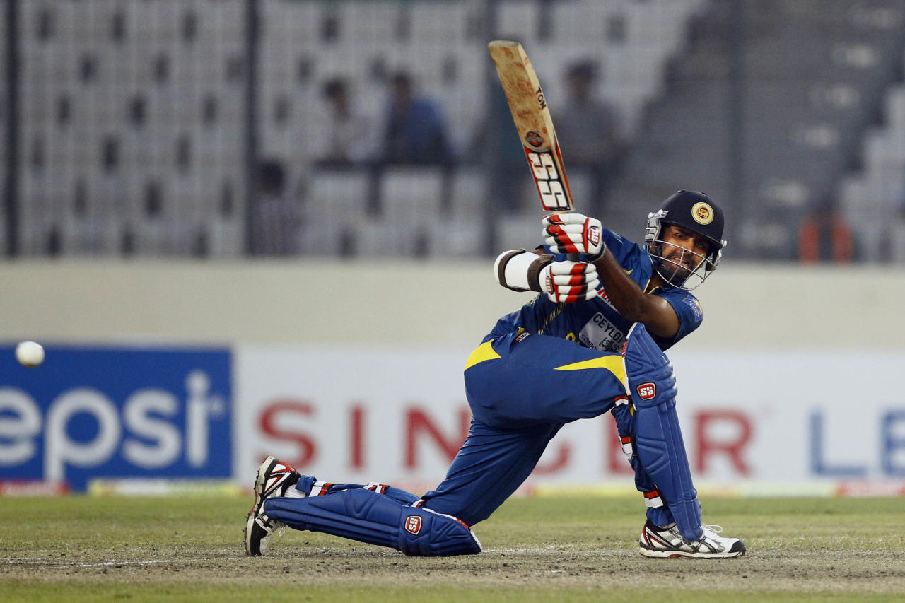 Sri Lanka's Lahiru Thirimanne plays a shot on the third one day international cricket match against Bangladesh in Dhaka, Bangladesh, Saturday, Feb. 22, 2014. (AP Photo/A.M. Ahad)