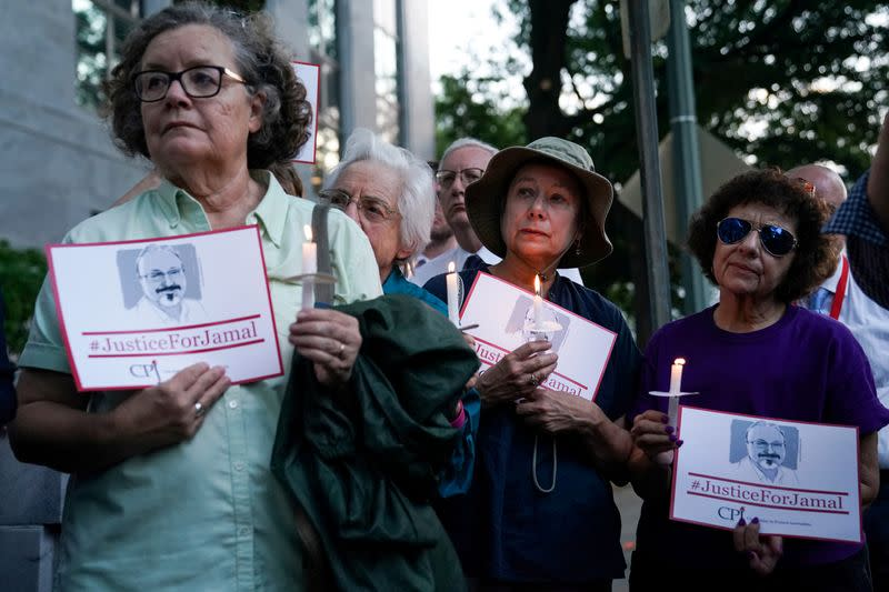 FILE PHOTO: The Committee to Protect Journalists and other press freedom activists hold a candlelight vigil in front of the Saudi Embassy in Washington D.C. to mark the anniversary of the killing of journalist Jamal Khashoggi
