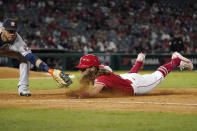 Los Angeles Angels' Brandon Marsh, right, is tagged out at first by Houston Astros first baseman Yuli Gurriel after being caught off base during the sixth inning of a baseball game Wednesday, Sept. 22, 2021, in Anaheim, Calif. (AP Photo/Mark J. Terrill)