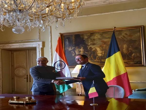India's Ambassador to Belgium Santosh Jha signing agreement on mutual legal assistance in criminal matters with Belgium's Deputy Prime Minister Vincent Van Quickenborne.