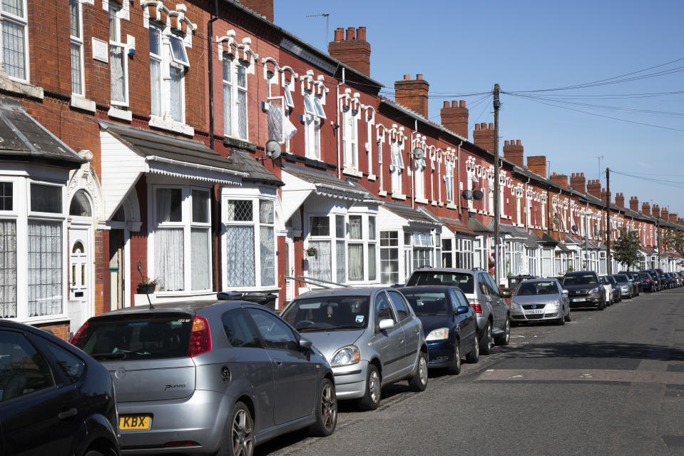 Terraced housing on Ombersley Road in Sparkbrook in Birmingham, United Kingdom. In architecture and city planning, a terraced or terrace house or townhouse exhibits a style of medium-density housing that originated in Europe in the 16th century, where a row of identical or mirror-image houses share side walls. (photo by Mike Kemp/In PIctures via Getty Images)