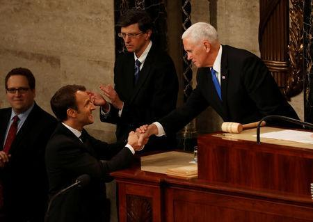 French President Emmanuel Macron is greeted by U.S. Vice President Mike Pence before addressing a joint meeting of Congress in the House chamber of the U.S. Capitol in Washington, U.S., April 25, 2018. REUTERS/Aaron Bernstein