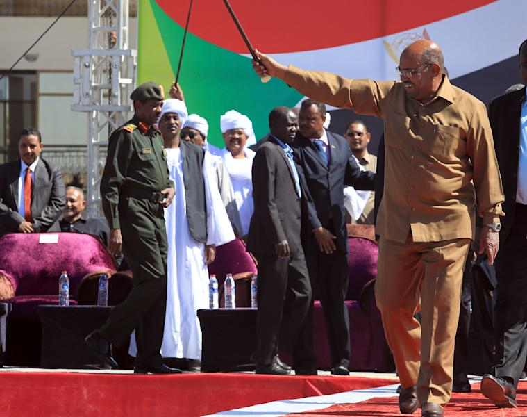 """Sudan's President Omar al-Bashir greets his supporters at a rally in Khartoum, Sudan, Wednesday, Jan. 9, 2019. Al-Bashir told the gathering of several thousands of supporters in the capital that he is ready to step down only """"through election."""" The remarks come after three weeks of anti-government protests. (AP Photo/Mahmoud Hjaj)"""