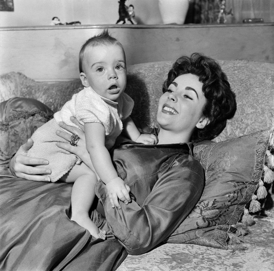 <p>Elizabeth and Michael Wilding welcomed their first child together, a son named Michael Jr., in 1953. </p>