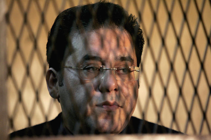 Opposition leader Ayman Nour stands in a court in Cairo January 23, 2007. (Nasser Nuri/Reuters)