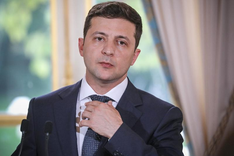 """""""Tourists have always said that Ukraine is very beautiful, the food there is very tasty and the people are very beautiful, especially the women,"""" the recently elected leader said (AFP Photo/ludovic MARIN)"""
