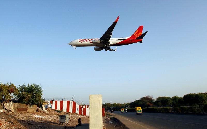 FILE PHOTO - A SpiceJet Boeing 737 passenger aircraft prepares to land at Sardar Vallabhbhai Patel international airport in Ahmedabad