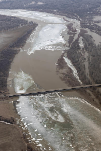 This Wednesday, March 27, 2019, photo provided by the North Dakota Governor's Office shows lengthy ice jams that have backed up in the Yellowstone River, and flooding that had prompted the evacuation of dozens of homes in western North Dakota and eastern Montana. North Dakota Gov. Doug Burgum declared a statewide flood emergency after touring the area. A submerged section of Highway 200 between Cartwright, N.D., and Fairview, Mont., remained closed Wednesday. (Mark Staples/North Dakota Governor's Office via AP)