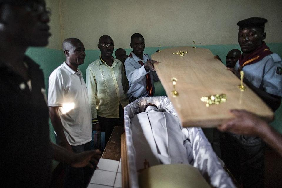 Pall bearers close the coffin over the body of Reverand Paul-Emile Nzale who was killed in the attack on the Fatima church in Bangui on May 28, as it is prepared for burial on June 4, 2014 (AFP Photo/Marco Longari)