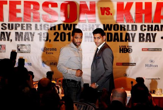 LONDON, ENGLAND - MARCH 13: Amir Khan (R) and Lamont Peterson during a press conference at Hilton London Metropole on March 13, 2012 in London, England. (Photo by Scott Heavey/Getty Images)