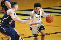 Vanderbilt guard Scotty Pippen Jr. (2) drives as Richmond guard Andre Gustavson defends during the first half of an NCAA college basketball game Wednesday, Dec. 16, 2020, in Nashville. (AP Photo/John Amis)