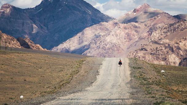 PHOTO: A traveler on the M41 road (also called Pamir highway), crossing the Pamir plateau in Tajikistan. (Getty Images)