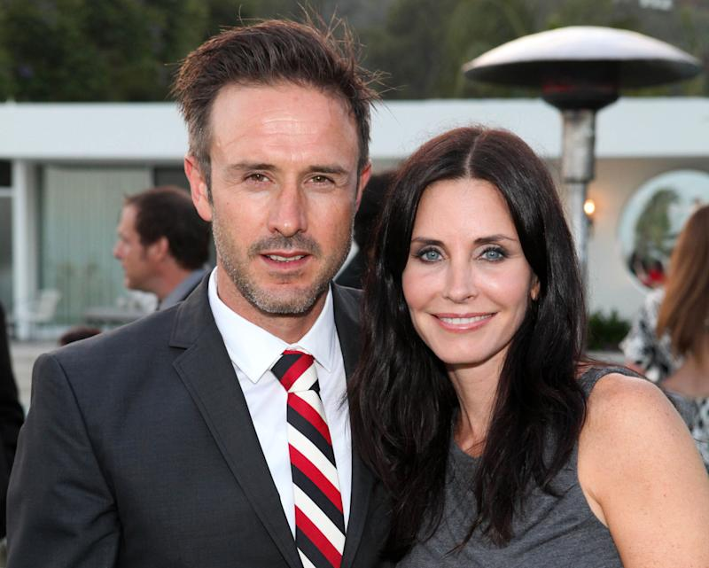 FILE - This June 28, 2011 file photo originally released by InStyle, David Arquette, left, and Courteney Cox attend the Beau Joie Champagne Art Of Elysium Dinner hosted by Rachel Bilson and held at Arquette's home in Beverly Hills, Calif. Cox asked a judge to drop her husband's name from her name once her divorce from actor David Arquette is finalized. Cox and Arquette each cite irreconcilable differences for the end of their 12-year marriage. Arquette filed the petition on Friday in Los Angeles and the paperwork indicates he is self-represented.  (AP Photo/InStyle, Casey Rodgers)