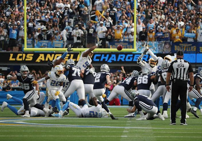 Greg Zuerlein kicks a 56- yard field goal as time expires to lift the Dallas Cowboys to victory over the Chargers.
