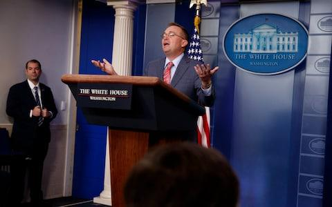 White House chief of staff Mick Mulvaney announces the decision - Credit: Evan Vucci /AP