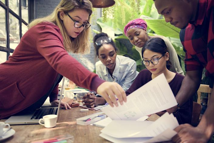 """<span class=""""caption"""">Women leaders tend to collaborate well with their team.</span> <span class=""""attribution""""><a class=""""link rapid-noclick-resp"""" href=""""https://www.shutterstock.com/image-photo/friends-people-group-teamwork-diversity-557769019?src=u4fE9fJEL419tMwnN87ZOg-1-89"""" rel=""""nofollow noopener"""" target=""""_blank"""" data-ylk=""""slk:Rawpixel.com/Shutterstock.com"""">Rawpixel.com/Shutterstock.com</a></span>"""
