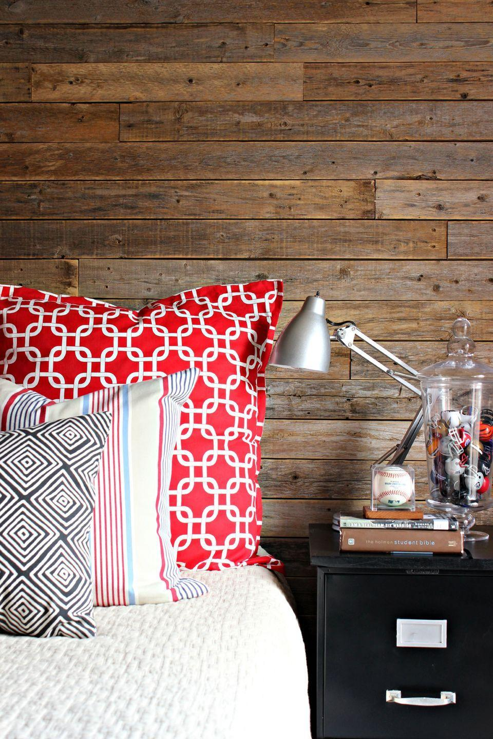 "<p>Skip the pros and DIY your own plank wall like in <a href=""https://www.goodhousekeeping.com/home/decorating-ideas/g1033/dimples-and-tangles-home/"" rel=""nofollow noopener"" target=""_blank"" data-ylk=""slk:this bedroom"" class=""link rapid-noclick-resp"">this bedroom</a>. Paired with bold linens, the rustic wood feels fresh, not quaint. </p><p><a href=""https://www.goodhousekeeping.com/home/decorating-ideas/a22994659/cheap-throw-pillows/"" rel=""nofollow noopener"" target=""_blank"" data-ylk=""slk:RELATED: Just Try to Resist Buying One of These Cute Throw Pillows for Under $20"" class=""link rapid-noclick-resp""><strong>RELATED:</strong> Just Try to Resist Buying One of These Cute Throw Pillows for Under $20</a></p>"