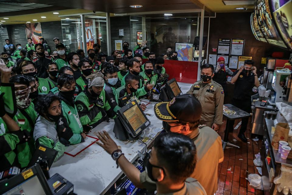 Food delivery riders queue up at a McDonalds outlet in Bogor on June 9, to buy the new BTS-meal deal for hungry fans in the K-Pop mad country. Source: AFP via Getty Images