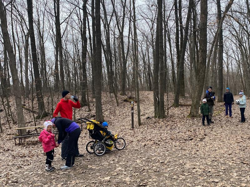 A family hiking at the Greenbush Trails in the Kettle Moraine State Forest.