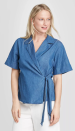 """<p><strong>Who What Wear</strong></p><p>target.com</p><p><strong>$34.99</strong></p><p><a href=""""https://www.target.com/p/women-s-short-sleeve-tie-front-blouse-who-what-wear/-/A-78673846"""" rel=""""nofollow noopener"""" target=""""_blank"""" data-ylk=""""slk:Shop Now"""" class=""""link rapid-noclick-resp"""">Shop Now</a></p><p>A simple, blue wrap-tie top paired with <a href=""""https://go.redirectingat.com?id=74968X1596630&url=https%3A%2F%2Fwww.asos.com%2Fus%2Fasos-design%2Fasos-design-linen-slide-pants%2Fprd%2F13474603&sref=https%3A%2F%2Fwww.goodhousekeeping.com%2Fholidays%2Fg32302046%2Ffourth-of-july-outfit-ideas%2F"""" rel=""""nofollow noopener"""" target=""""_blank"""" data-ylk=""""slk:wide leg pants"""" class=""""link rapid-noclick-resp"""">wide leg pants</a> and <a href=""""https://go.redirectingat.com?id=74968X1596630&url=https%3A%2F%2Fwww.zappos.com%2Fp%2Fsteven-new-york-greece-sandal-white-leather-1%2Fproduct%2F9034058%2Fcolor%2F405513&sref=https%3A%2F%2Fwww.goodhousekeeping.com%2Fholidays%2Fg32302046%2Ffourth-of-july-outfit-ideas%2F"""" rel=""""nofollow noopener"""" target=""""_blank"""" data-ylk=""""slk:white leather sandals"""" class=""""link rapid-noclick-resp"""">white leather sandals</a> will create the perfect balance of fancy and casual. Throw on a pair of red earrings, and your patriotic look will be complete. <br></p>"""