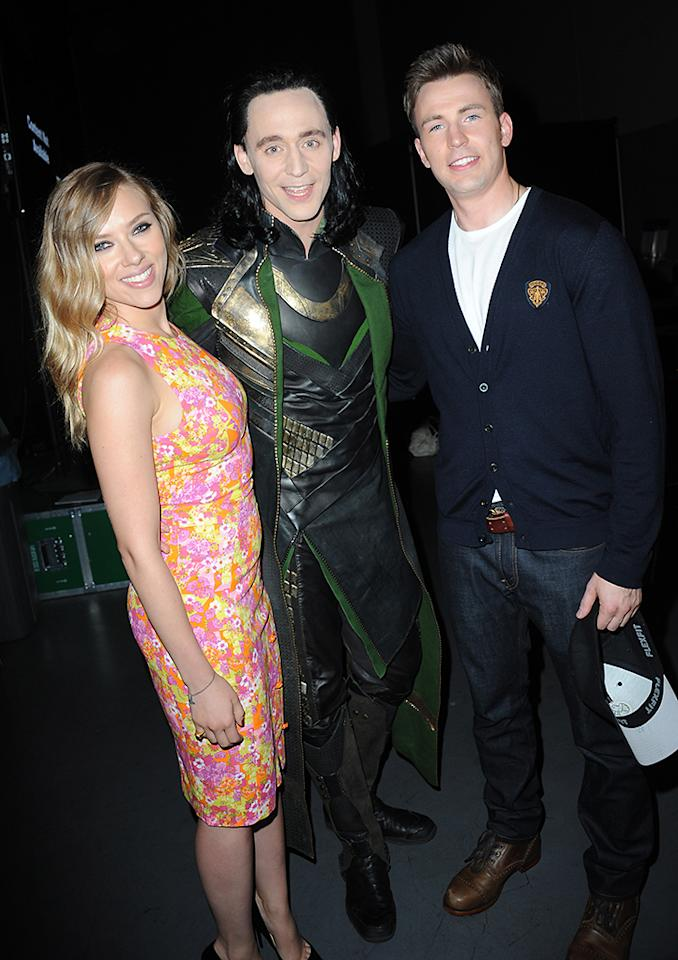 "SAN DIEGO, CA - JULY 20:  Actors Scarlett Johansson, Tom Hiddleston, and Chris Evans pose backstage at Marvel Studios ""Thor: The Dark World"" and ""Captain America: The Winter Soldier"" during Comic-Con International 2013 at San Diego Convention Center on July 20, 2013 in San Diego, California.  (Photo by Albert L. Ortega/Getty Images)"